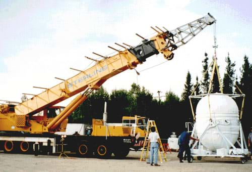Photograph of a large crane lifting a heavy object.