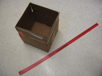 Photo shows a 1 foot by 1 foot box with an open top. A red yardstick lies nearby.