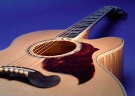 Photograph of a six-stringed wooden guitar.