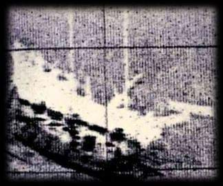 Grainy image shows the shape of a sunken ship.