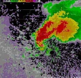 A computer simulation image of the radar reflectivity image of a tornado looks like concentric swirls of red, orange, yellow and green on a dark map.
