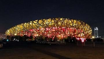 The Beijing National Stadium (Bird's Nest) at night where the 2008 Olympics were held.