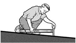 A black and white graphic of a man measuring slope using a 24-inch level and tape measure.