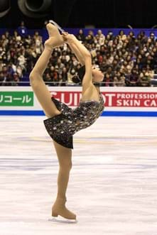 A professional figure skater performing a biellmann spin at the 2009 GPF.