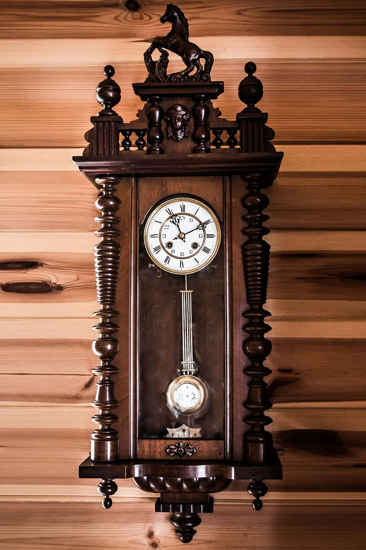 A wooden clock with a pendulum