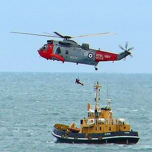 A boat and helicopter at sea.