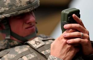 A staff sergeant in the army using a GPS receiver.