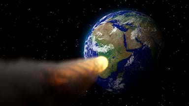 A fiery asteroid approaching planet Earth.