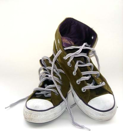 A photograph shows a pair of dark green high-top laced sneakers with rubber soles, edges and toe caps.