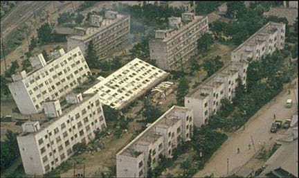 Multistory buildings rest at various tilted angles because of soil liquefaction following the 1964 Niigata earthquake in Japan.