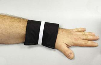 A photograph shows a forearm with a black wrap around the wrist—a medical device to help people with Raynaud's disease treat painfully cold hands, fingers, feet and toes.