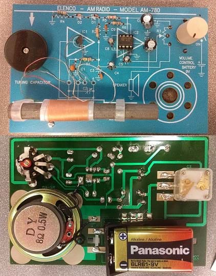 Photo shows all the parts of an assembled AM radio kit, including circuit boards,  battery and speaker.