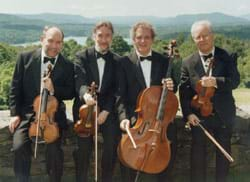 Four men in tuxedos hold various stringed instruents and bows.