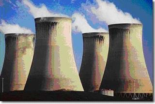 A photograph shows four concrete cooling towers.