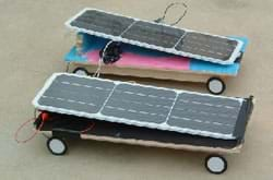 Photo shows two solar cars built by middle school students from Rogers Herr Middle School in Durham, NC, while participating in the Duke University Techtronics Program. They look like solar panels on skateboards.
