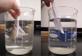 Two photos show items submerged under water in beakers: (left) a tan material, and (right) a swatch of blue cloth.