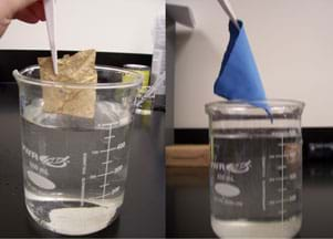 Two photos show items just removed from being submerged underwater in beakers: (left) a brown material, and (right) a swatch of blue cloth; both look dry.