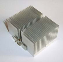 A photograph shows a metal device that looks like about 50 thin square metal pieces lined up next to each other but not touching, like a mini radiator.
