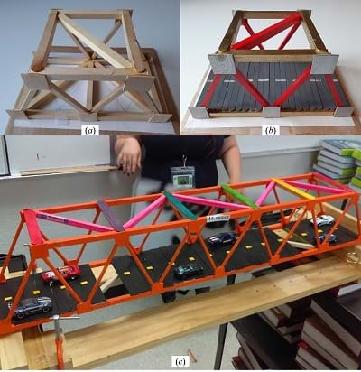Truss bridge reinforced with braces, finished with a deck, and decorated.