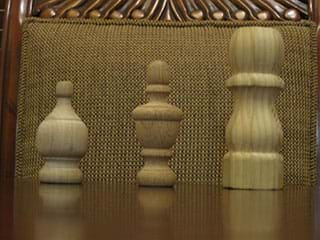 A photograph shows three wooden finials of varying sizes; they look somewhat like chess pieces. A finial is a distinctive ornament at the apex of a roof, pinnacle, canopy or similar structure in a building or object (such as a lamp).