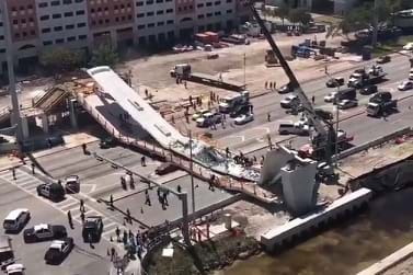 A concrete pedestrian bridge that collapsed before it was complete.