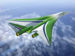 Drawing shows a futuristic green supersonic jet flying fast and high above the clouds.