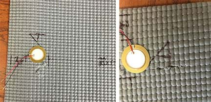 Two photographs show the rubber mat of Figure 1 with notches added: (left) The notch near location A is very small. (right) A scissors cut the mat in a thin line near location A.