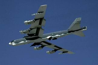 A photograph shows an airplane in flight, a B-52 Stratofortress, which is a long-range, heavy bomber airplane that can perform a variety of missions.