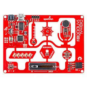 "The product image of a digital sandbox microcontroller. The rectangular red board has smaller processors scattered on it, and the text ""digital sandbox"" is written in white on the top right corner."