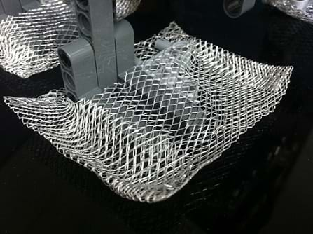 Photo shows the robot foot with square extensions made of metal mesh material.