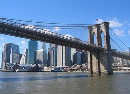 Photograph of the Brooklyn Bridge with the skyscrapers of Manhattan in the background.