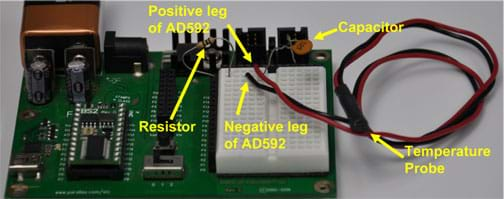 Photo shows a circuit board with attachments labeled: resistor, positive leg of AD592, negative leg of AD592, capacitor and temperature probe.
