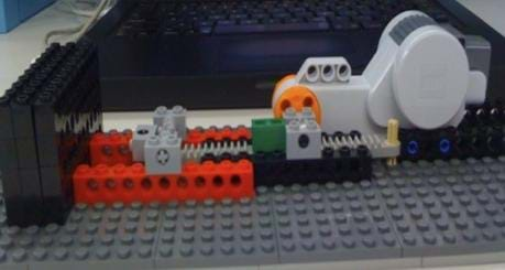 A photograph shows LEGO plastic parts, a compressor and motor.