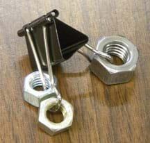 A photograph shows an office paper binder clip with one large and two smaller hex nuts slipped onto the wires on either side of the clip.
