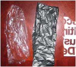 A photograph shows three rectangles of different types of plastic materials suitable for this activity. Left to right: a lightweight clear plastic (from a dry cleaning bag); a dark-colored slightly heavier plastic (from a trash bag); and a thicker plastic with writing printed on it (from a department store bag).