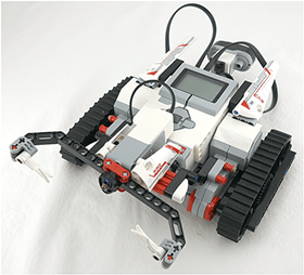 An image of a two-wheeled EV3 robot pushing a water bottle across a surface.