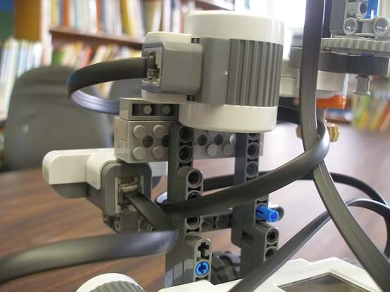 Photo shows how the front-facing and side-sensor are attached to the robot
