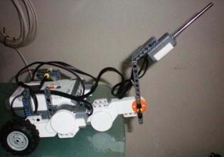 Photo shows a LEGO NXT robot with a temperature sensor attached.