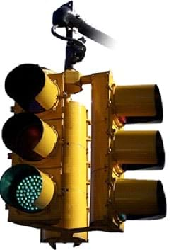 Photo shows a 3-way traffic light, each prong with three lights—one for red, yellow and green.
