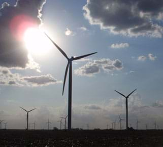 Landscape photo shows a wind turbine farm in Indiana.
