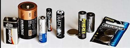 A photograph showing commonly used batteries of various styles and supplying voltage.