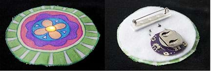 A photograph shows the front and back of a completed, three-inch circle-shaped pin. On the left, the front, a LED light shines through the center of a colorful flower design on white fabric. On the right, the finished back of the pin shows a disc battery in its holder, conductive thread tracers, and a safety pin-type fastener for clothing attachment.