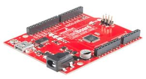 A photograph shows a circuit board with its base board a bright red color.