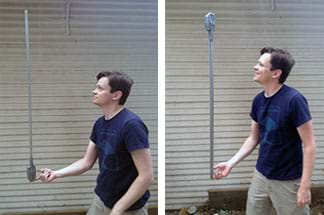 Two photographs show a man balancing with just his right index finger a three-foot stick with a weight on one end (four taped-on penny rolls). On the left, he tries to balance it with the heavier end at the bottom (near his hand), and on the right, he tries to balance it with the weight on the top. He is smiling in the latter case.