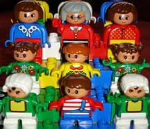 A photograph shows nine LEGO DUPLO people, small and colorful toy figures.
