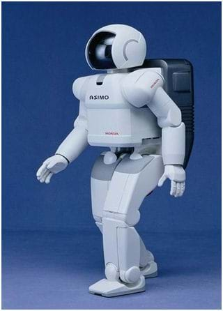 Photo shows a bi-pedal robot that looks like a man in a white spacesuit and helmet.