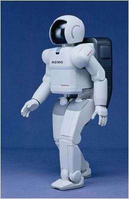 A photo of a bi-pedal robot that looks like a man in a white space suit and helmet.