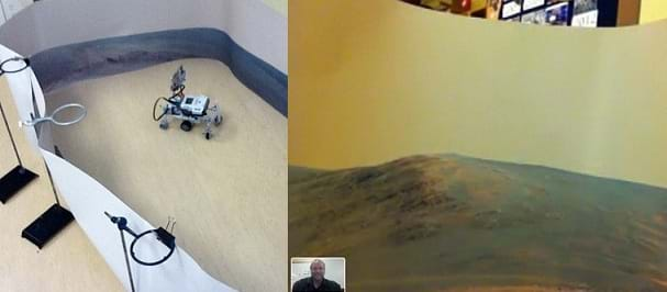 Two photos: (left) A LEGO robot acting as a Mars Rover, being controlled remotely by an Android device. The robot is within a space surrounded by a large circular paper wall, simulating a 360° image of the surface of Mars (printed on the paper). The paper is supported by ring stands, clipped to the paper with large black paperclips. (right) A screen capture from an iPod camera attached to the LEGO robot (rover) shows the simulated Mars environment of a paper wall with a printed image of the surface of Mars, and just above the paper wall, a glimpse of the classroom in the background. In the bottom left hand corner is an image of the teacher from the Facetime App.