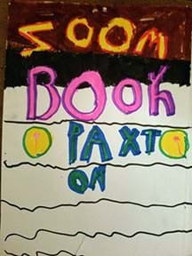 "A photograph shows a hand-drawn book cover with the title, ""Zoom Book by Paxton."""