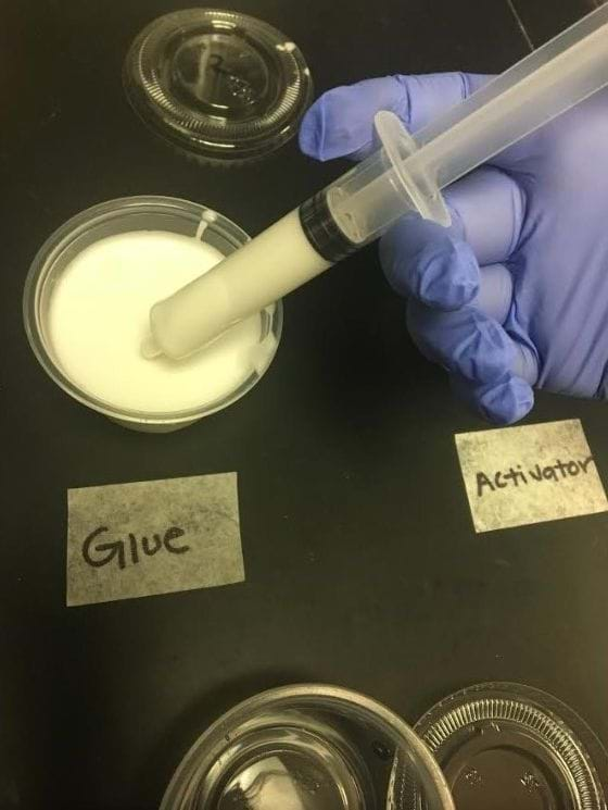 An image showing how the syringe draws up glue into the container.